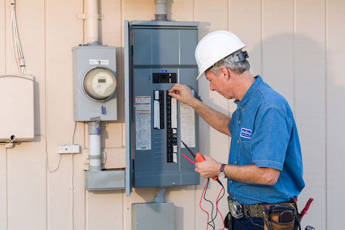 Qualified Electrician in FL with electrical panel.